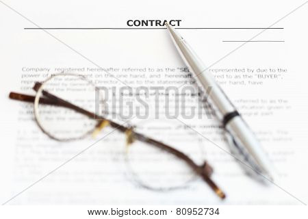 Silver Pen And Eyeglasses On Sales Agreement
