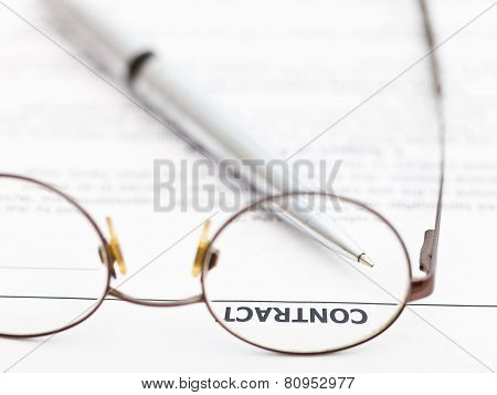 Contract And Silver Pen Through Spectacles