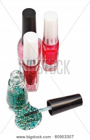 Nail Polish Bottles And Spilled Green Lacquer