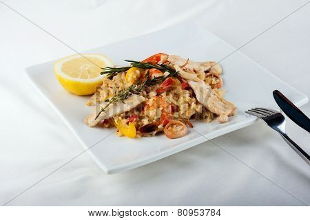 The Plate With Paella In Restaurant - Spanish Dish With Sea Food