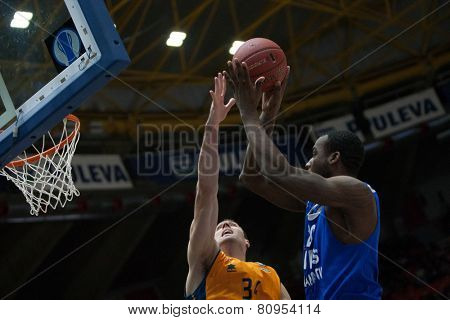 VALENCIA, SPAIN - JANUARY 21: Cooper with ball and Aguilar during Eurocup match between Valencia Basket Club and CSU Asesoft at Fonteta Stadium on January 21, 2015 in Valencia, Spain