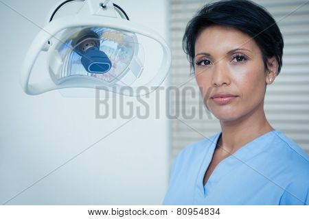 Portrait of serious young female dentist
