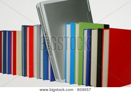 Laptop between Books