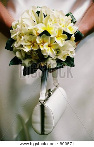 Wedding bouquet and handbag