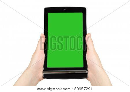 Hands holding touch screen tablet pc with green screen