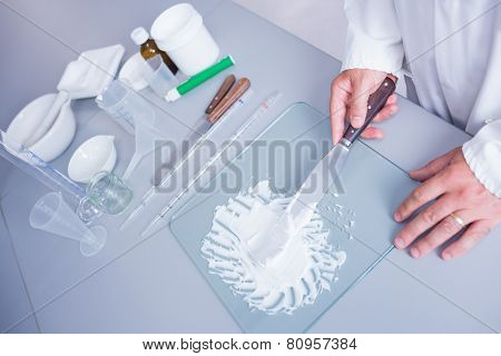 Close up of a biochemist making some medicine in laboratory