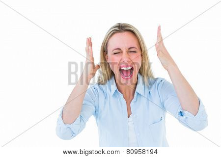 Furious blonde standing and screaming on white background