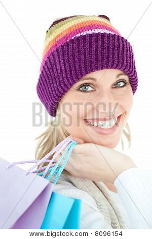 Brght Woma Holding Shopping Bags Wearing A Colourful Hat