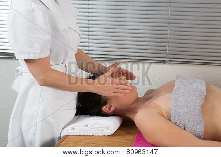 A Woman Spirit Healer Doing Reiki Treatment To A Woman