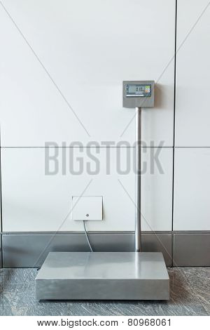 An Airport Self Service Check In Booth/kiosk With Attached Baggage Scales