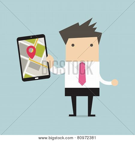 Businessman holding tablet computer with navigation map and pin pointer on the screen