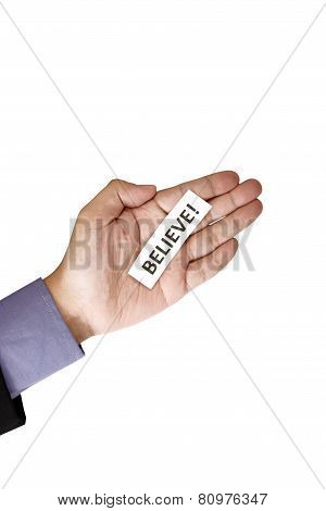 Hand Holding Paper With Believe Text