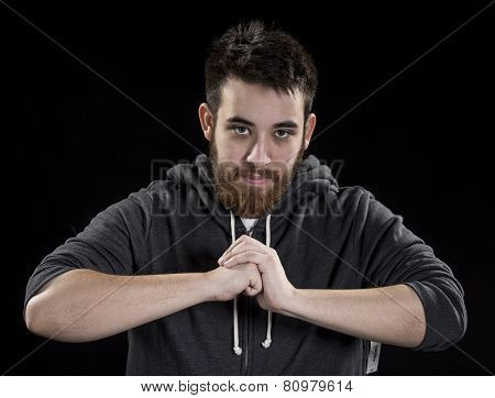 Serious Man with Closed Fist In Front his Body