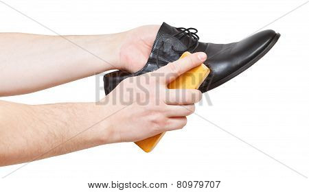 Shoeshiner Brushing Black Shoe By Brush