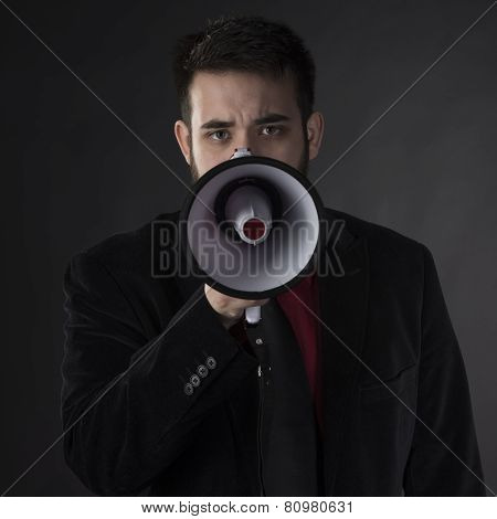 Close up Serious Man Holding Megaphone