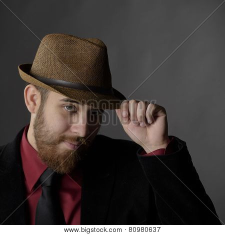 Goatee Man in Formal Wear with Brown Hat