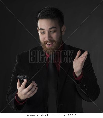Surprised Businessman Looking at his Phone