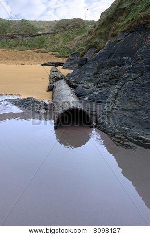 Rusty Metal Overflow Seashore Pipe