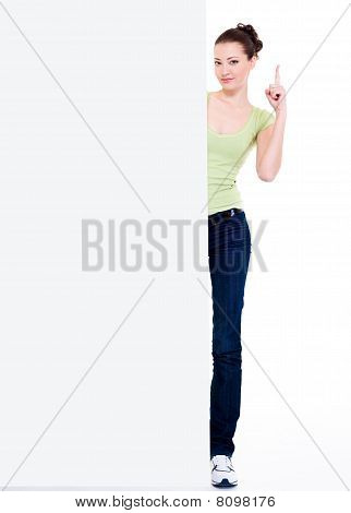 Girl Look Out From Blank Empty Banner With Lift Forefinger Up