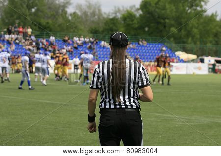 Belgrade Serbia - May 05 2014: The only female football referee Ivana Lazic in Serbia. American Football Match Between Belgrade Wolves And Blue Dragon in Belgrade. The Wolves team is winner.