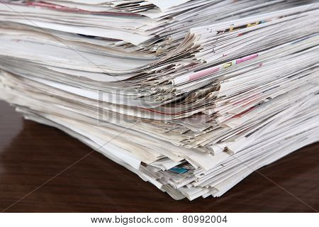 Newspapers Pile On The Table