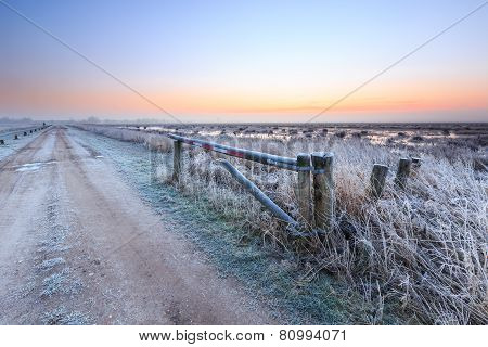 Sunrise On A Cold Winter Day Of A Rural Landscape