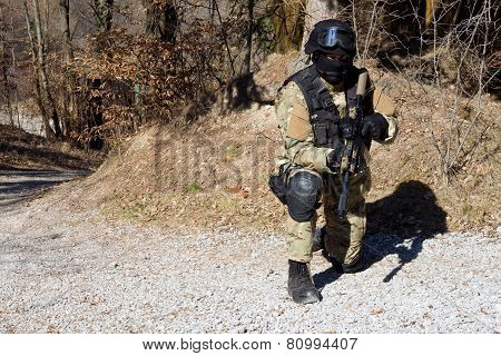special police unit, masked police officer with a weapon
