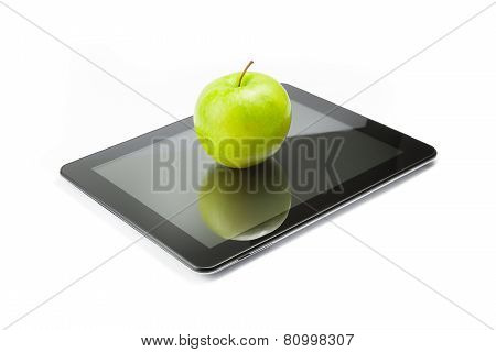 Green Apple On Digital Tablet Pc On White Background