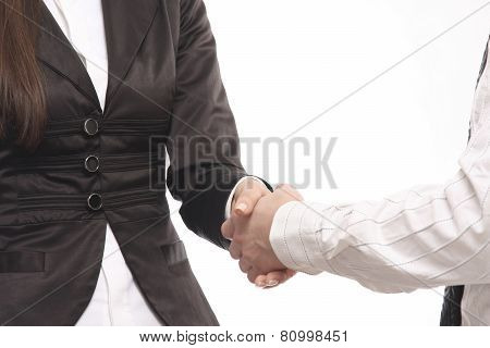 Close-up of business people shaking hands against a white background
