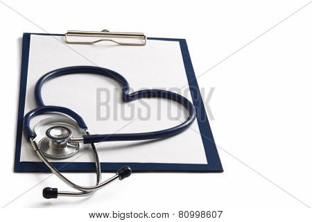 A blue statoscope in the shape of a heart on a file
