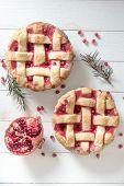 stock photo of tarts  - Sweet tart cake stuffed with pomegranate jam - JPG