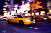image of new york night  - A taxi travels through Times Square in New York City - JPG