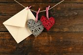 stock photo of revelation  - Love letter hanging on rope on rustic wooden background - JPG