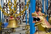 picture of dragon head  - old brass bell and dragon head in asia temple Nepal - JPG
