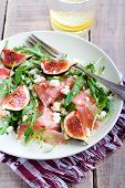 image of rocket salad  - Rocket feta fig and prosciutto salad selective focus - JPG