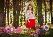 picture of girl walking away  - Cute little girl in red looking away - JPG