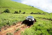 stock photo of dangerous  - 4x4 Vehicle Traveling on Dangerous Dirt Road in Nyika Plateau - JPG