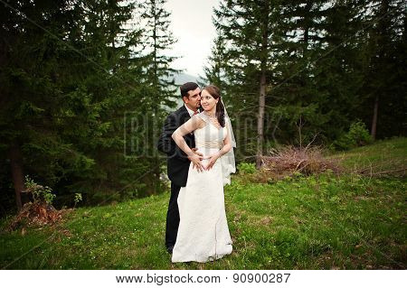 Wedding Couple  Holding Hands In A Forest