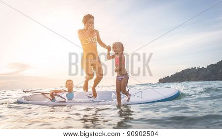Happy Family Diving In The Water