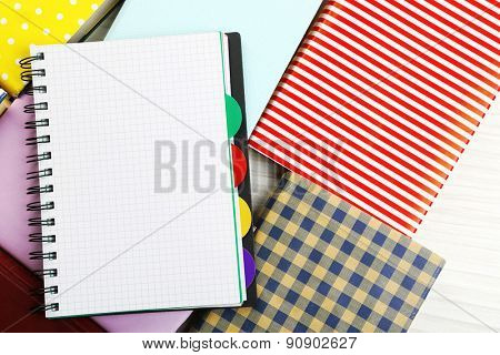Notebook on books background
