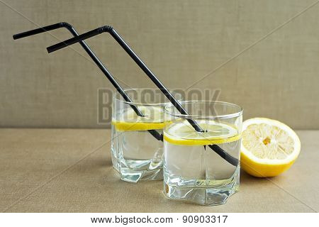 Two Glasses With Lemonade With Fresh Lemon