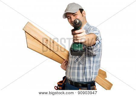 Portrait of a smiling carpenter holding wood planks. Bright background