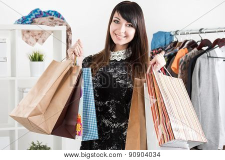 Young Beautiful Smiling Woman Holding Paper Bags