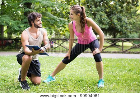 Smiling man showing a training program to a woman