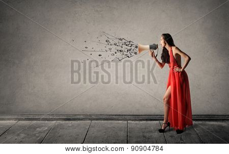 Girl shouting into a megaphone