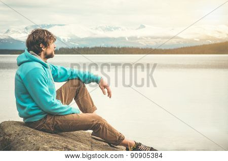 Young Man relaxing alone outdoor Lifestyle Travel concept