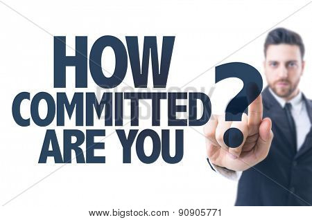 Business man pointing the text: How Committed Are You?