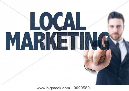 Business man pointing the text: Local Marketing