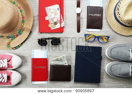 Set of trip stuff on wooden background
