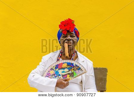 Old black lady dressed in typical cuban clothes